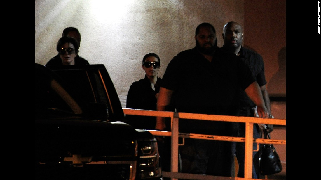 "Television personalities Kris Jenner, left, and Kim Kardashian, third from right, leave the Las Vegas hospital where basketball player Lamar Odom was being treated on Wednesday, October 14. The day before, Odom <a href=""http://www.cnn.com/2015/10/15/us/lamar-odom-condition/"" target=""_blank"">was found unconscious</a> at a brothel in Crystal, Nevada. Odom is technically still married to Khloe Kardashian, Jenner's daughter and Kim's sister. The couple signed divorce papers earlier this year, but the divorce has not been finalized, a source told CNN."
