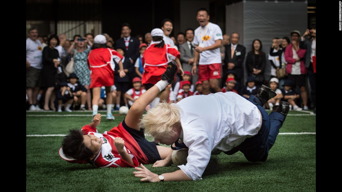"London Mayor Boris Johnson <a href=""http://www.cnn.com/2015/10/15/sport/london-mayor-boris-johnson-rugby/index.html"" target=""_blank"">knocks over 10-year-old Toki Sekiguchi</a> during a touch rugby game in Tokyo on Thursday, October 15. ""I accidentally flattened a 10-year-old on TV unfortunately,"" Johnson said in a speech to British and American businessmen. ""But he bounced back, he put it behind him. The smile returned rapidly to his face."""