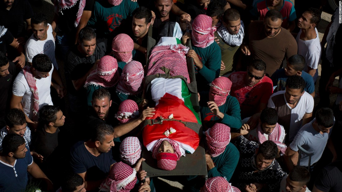 "Mourners carry the body of Muataz Ibrahim Zawahra, a Palestinian man who was killed in clashes with Israeli troops near the West Bank city of Bethlehem on Tuesday, October 13. In recent days, <a href=""http://www.cnn.com/2015/10/14/world/gallery/tensions-rise-israelis-palestinians/index.html"" target=""_blank"">there has been a spike in violence</a> across Israel and the Palestinian territories."