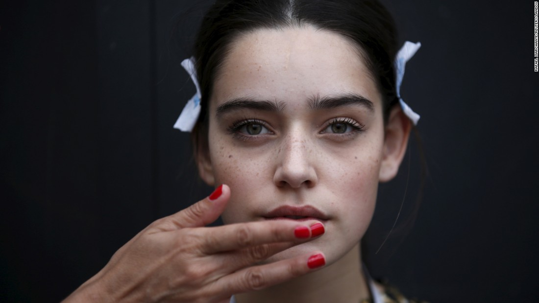 A model receives some final touches before a fashion show in Lisbon, Portugal, on Friday, October 9.