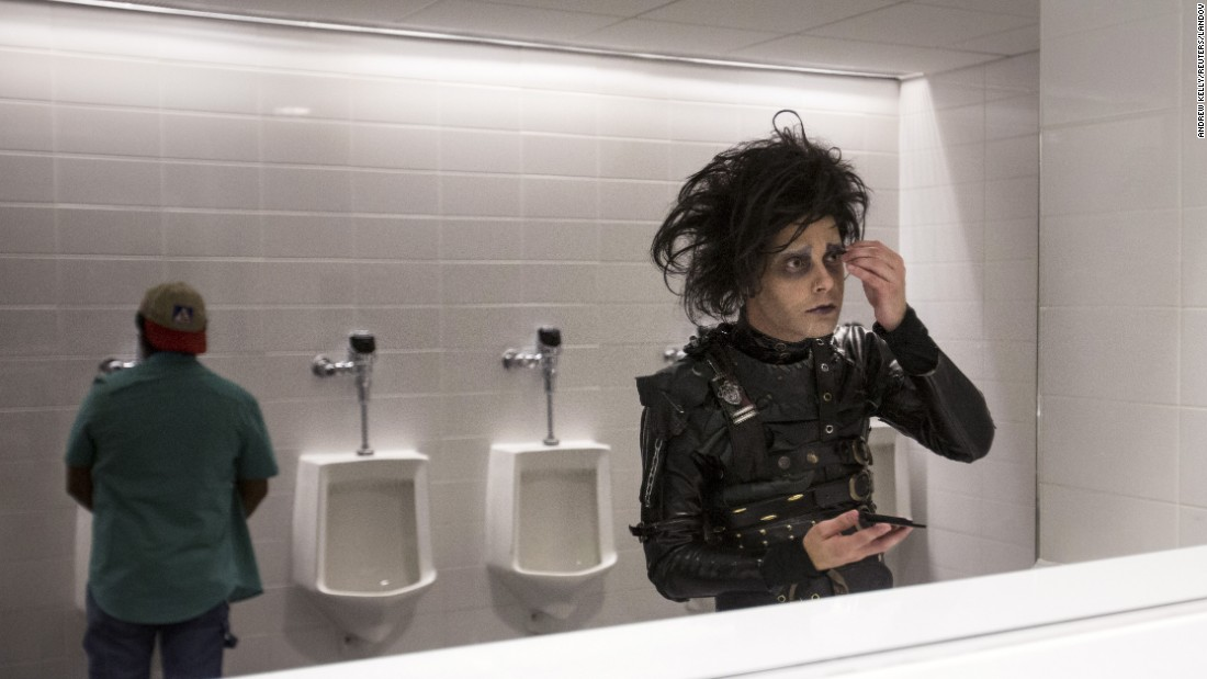 A man dressed as Edward Scissorhands applies makeup in the bathroom during New York Comic Con on Friday, October 9.