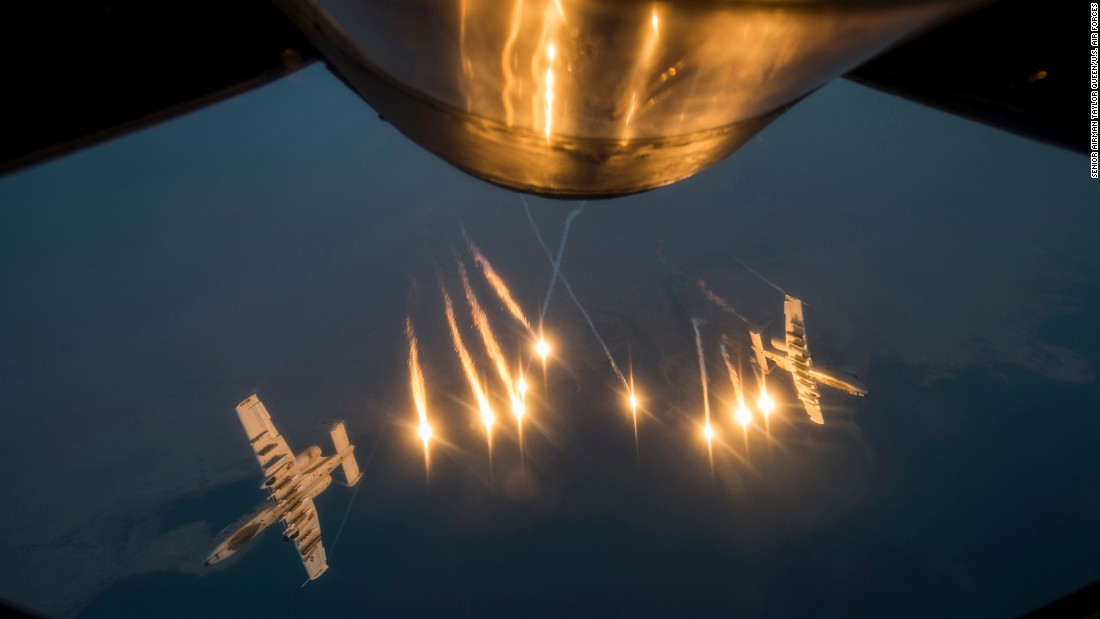 Two U.S. jets release flares after they fueled up over Southwest Asia on Tuesday, October 13.