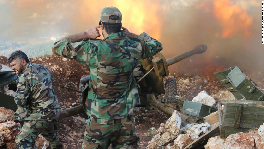 "Syrian army personnel fire a cannon in the country's Latakia Governorate on Saturday, October 10. The Syrian army, <a href=""http://www.cnn.com/2015/10/13/middleeast/syria-civil-war/"" target=""_blank"">backed by Russia,</a> has launched a recent offensive against rebels in central and northwestern regions."