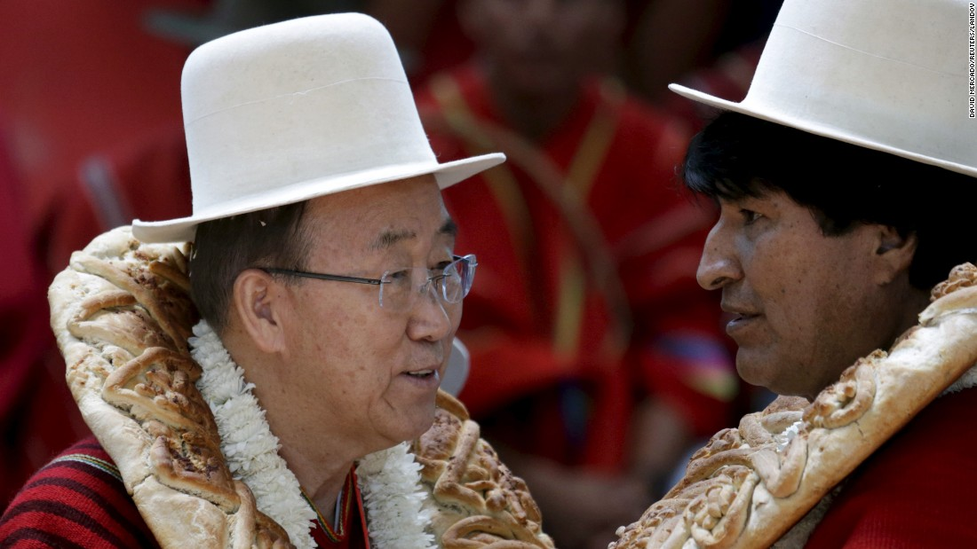 U.N. Secretary-General Ban Ki-moon, left, talks with Bolivian President Evo Morales during the inauguration of a sports arena in Vila Vila, Bolivia, on Sunday, October 11. Ban was in the country for a conference on climate change.