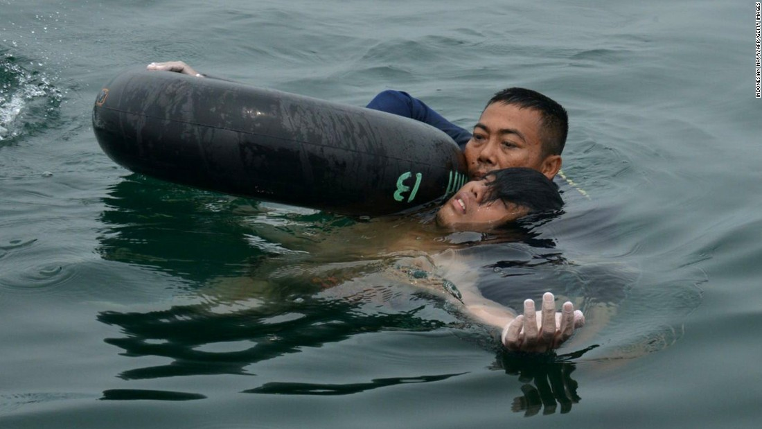 "A diver with the Indonesian Navy rescues Fransiskus Subihardayan, a 22-year-old man <a href=""http://www.cnn.com/2015/10/14/asia/indonesia-lake-helicopter-crash-survivor/"" target=""_blank"">who had survived in a lake for more than two days</a> after the helicopter he was traveling in crashed into the water. Subihardayan clung to floating plants before he was rescued on Tuesday, October 13."