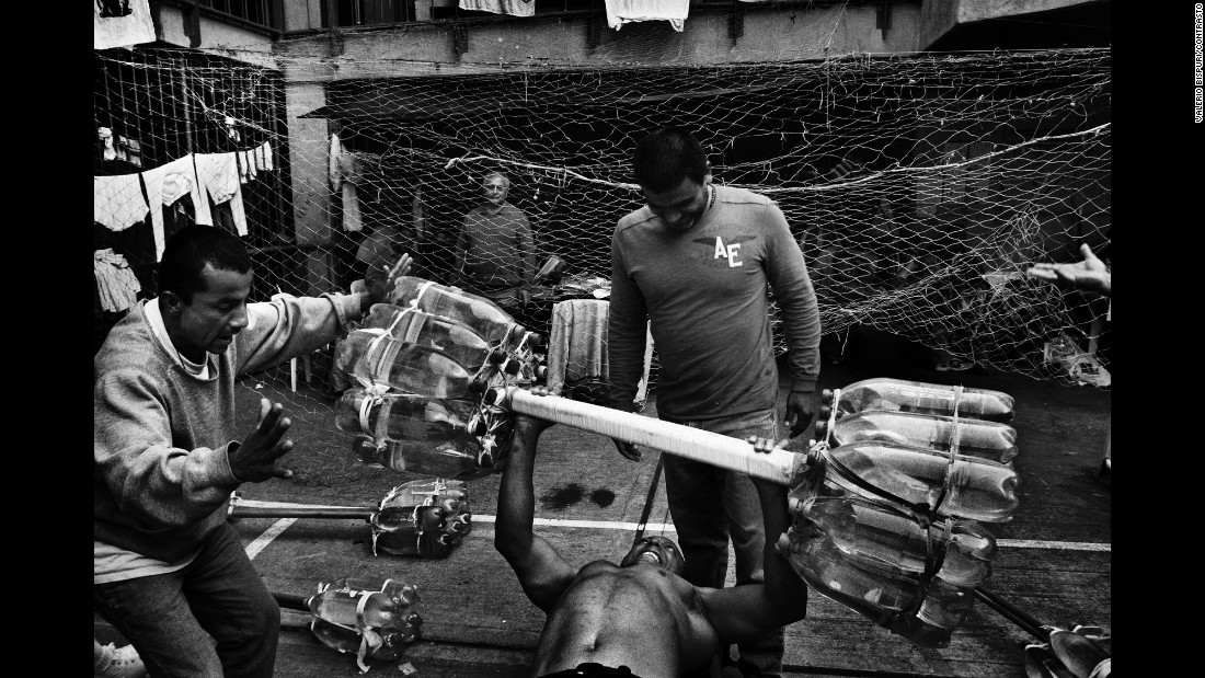 Prisoners lift a makeshift barbell at a prison in Bogota, Colombia, in 2007.