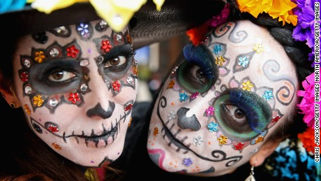 HIDALGO, MEXICO - NOVEMBER 02:  Girls in facepaint in Real del Monte on the 'Day of the Dead' on November 2, 2014 in Hidalgo,Mexico. The Royal Couple are on the first day of a four day visit to Mexico as part of a Royal tour to Colombia and Mexico.  (Photo by Chris Jackson/Getty Images)