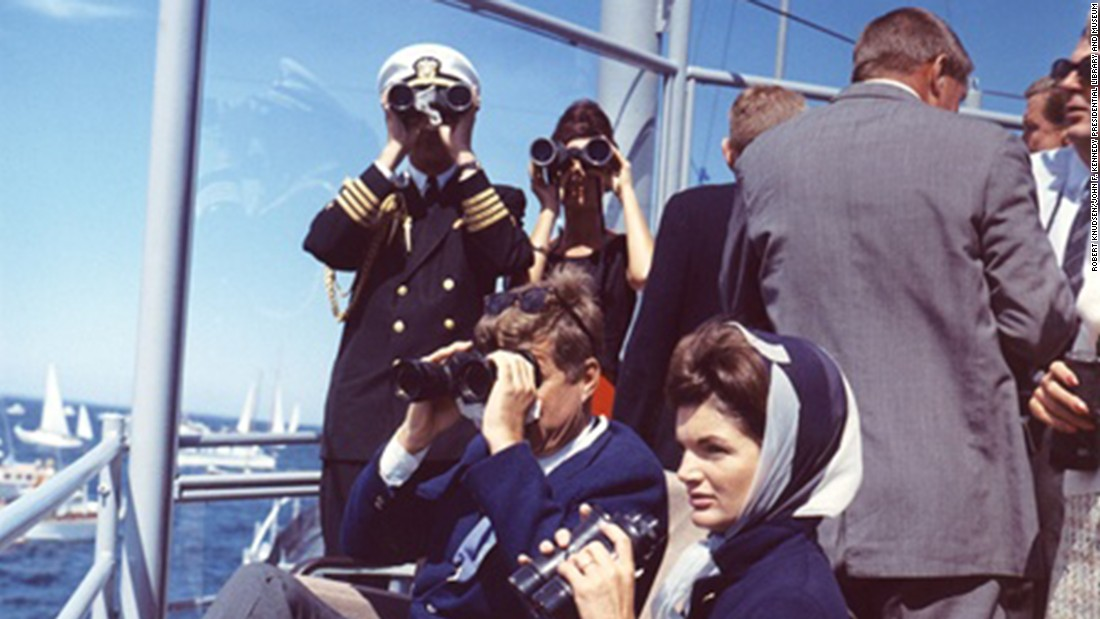 President and Mrs. Kennedy observe the America's Cup race off Newport, Rhode Island.