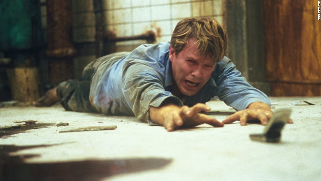 """Saw"" brought mass-market horror films a new level of graphic intensity. In the 2004 film, two men are chained in a bathroom, with each directed to kill the other. Its success led to six sequels and other films determined to out-gross the last -- in more ways than one."
