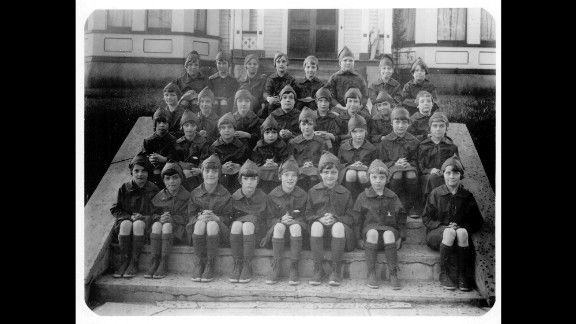 1920s: A troop of Girl Scout Brownies is shown wearing the first official Brownie uniform in 1926. Today's Brownies are second and third graders who start learning new skills through earning badges and doing projects to help their community.