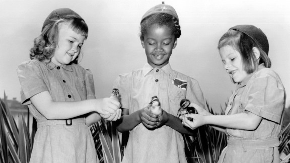 """1950s: An integrated group of Girl Scout Brownies learned farming firsthand, circa 1950. It wasn't just a fluke. In 1956, the Rev. Martin Luther King Jr. called the Girl Scouts  a """"force for desegregation."""" Today, that principle extends to transgender girls."""