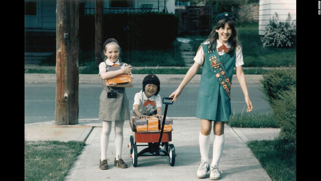 "<strong>1980s:</strong> A Girl Scout Junior helps Girl Scout Brownies with cookie deliveries, circa 1984. ""Cookies are so much more than a fundraiser,"" says psychologist Andrea Bastiani Archibald, the Girl Scouts' chief girls expert. ""When someone buys a box of cookies, they're helping girls develop their financial literacy skills, their social skills ... and their business ethics. Girls  can carry these skills into the rest of their lives."""