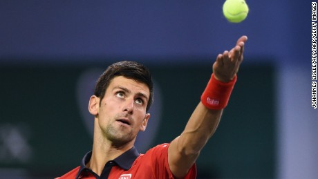 Novak Djokovic of Serbia serves during his men's singles semi-final match against Andy Murray of Britain at the Shanghai Masters tennis tournament in Shanghai on October 17, 2015.