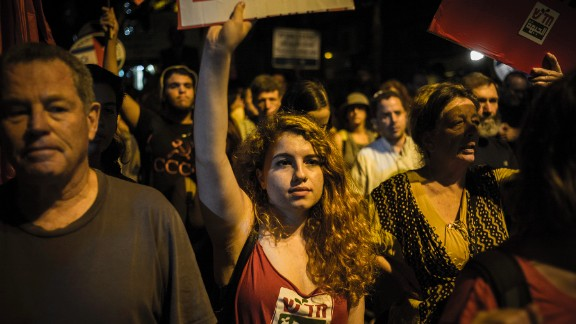 Left-wing activists march on Saturday, October 17, in Jerusalem. About 2,000 participants took part in an Arab-Israeli demonstration for peace. Israeli police and security forces remain on high alert around Israel and the West Bank.