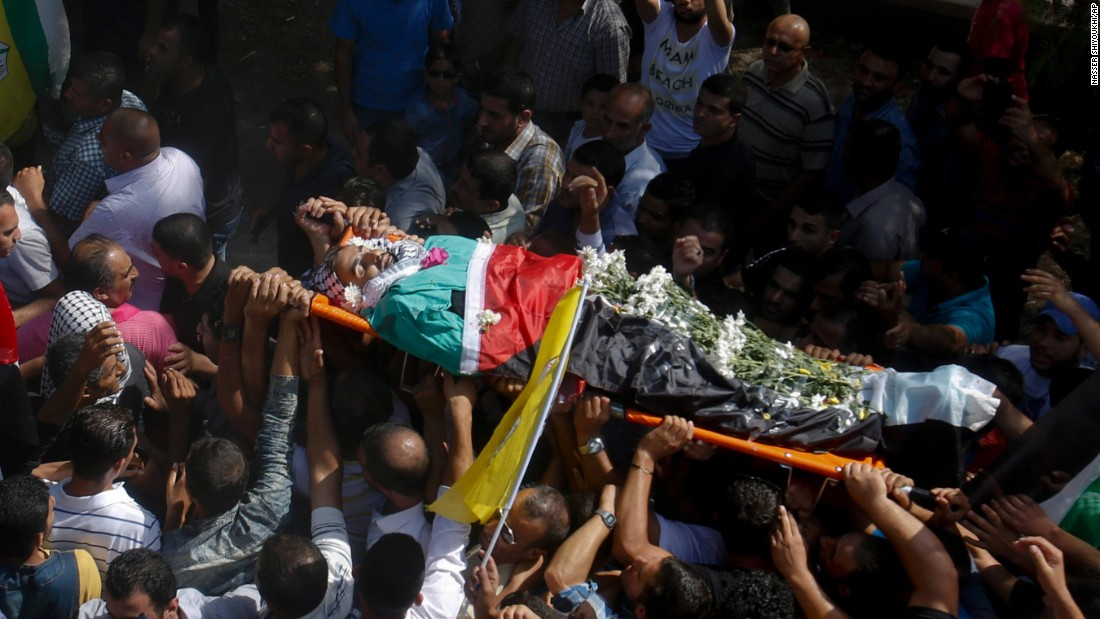 Palestinians carry the body of Iyad Awawdeh, 26, during his funeral in the West Bank village of Dora, near Hebron, on October 17. Awawdeh was killed after he stabbed an Israeli soldier, while posing as a journalist, during clashes Friday.