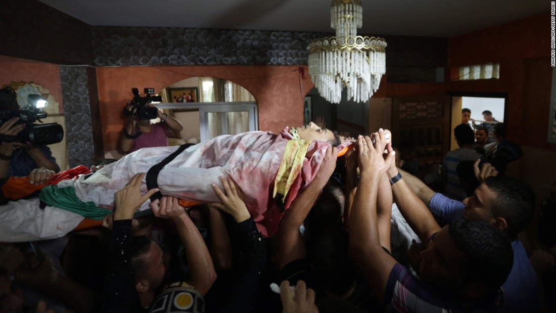 Palestinian mourners carry the body of Mahmud Homaida, who was killed by the Israeli military the day before, during his funeral in Gaza City. Homaida, 22, was killed near the Nahal Oz border crossing with Israel.