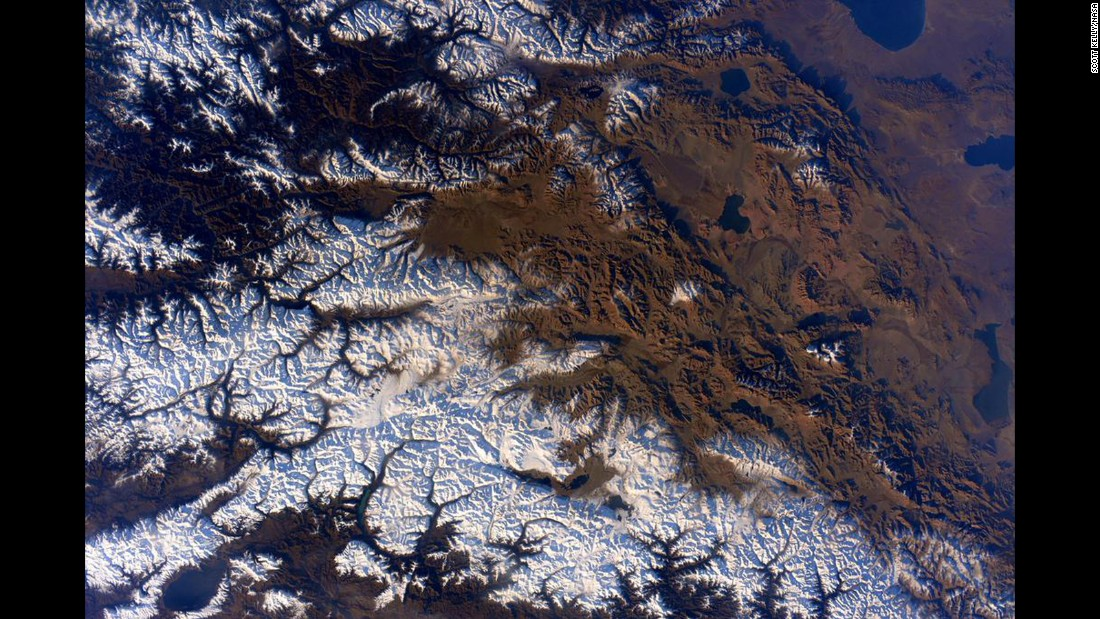 "On the day he broke the record for most days spent in outer space by an American, Scott Kelly tweeted this photo and the caption: ""Woke up to the #Himalayas outside our window this morning. #GoodMorning and #HappyFriday! #YearInSpace"""