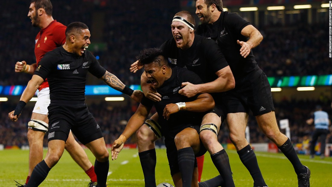 New Zealand players celebrate with triple try scorer Julian Savea.