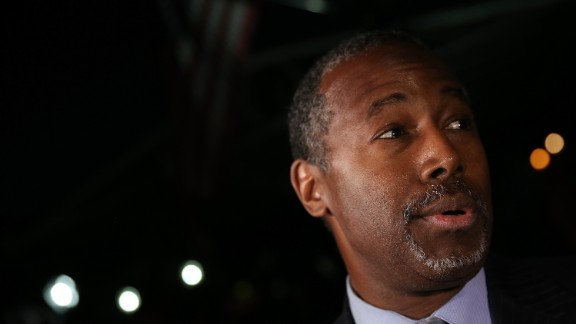Republican presidential candidate Dr. Ben Carson answers questions from members of the press after delivering brief remarks to supporters at the King Street Retail Walk October 16, 2015 in Alexandria, Virginia.