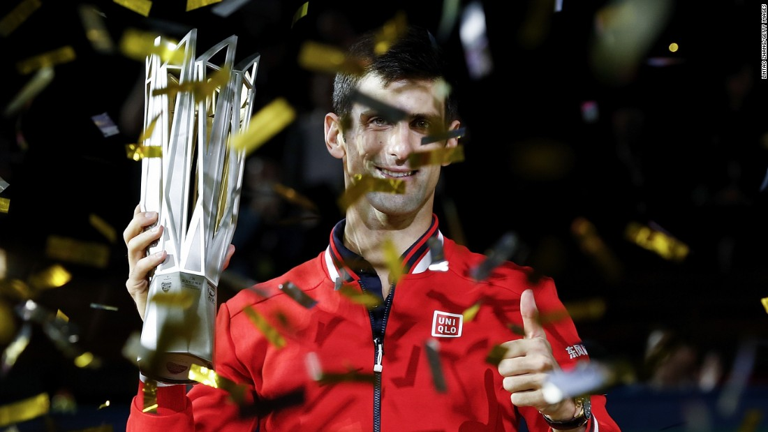 Novak Djokovic of Serbia poses with the winner's trophy after defeating Jo-Wilfried Tsonga of France in the title match at the Shanghai Masters.