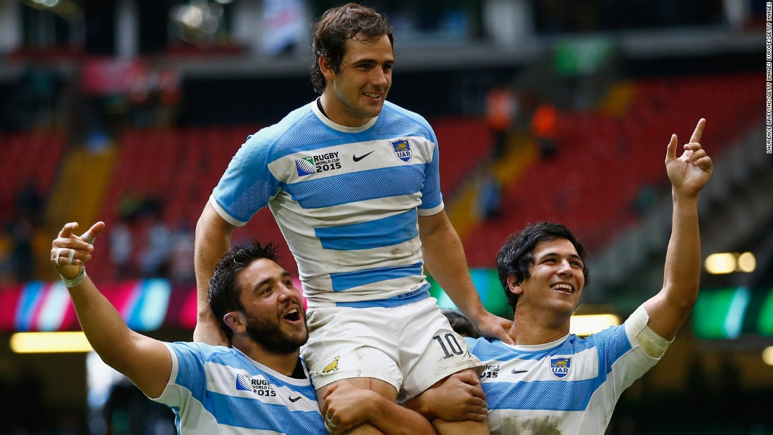 Nicolas Sanchez is lifted on the shoulders of his Argentina teammates Lucas Noguera and Matias Moroni after a superb victory over Ireland.
