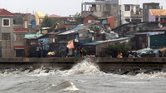 A man walks on a breakwater of Manila Bay in strong wind from Typhoon Koppu in Navotas,  Philippines, on Sunday October 18. Koppu is forecast to lumber over the country