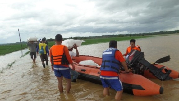 A Philippine Air Force rescue team uses rubber boats to distribute relief goods in Isabela province, northern Philippines, on October 18.