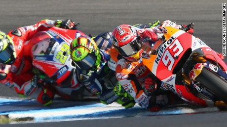 Marc Marquez of Spain leads on his Repsol Honda in a tightly contested Australia MotoGP at Phillip Island.
