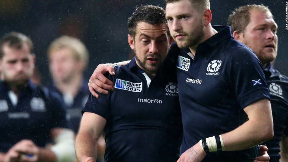 Greig Laidlaw and Finn Russell of Scotland trudge off after their 35-34 defeat to Australia.