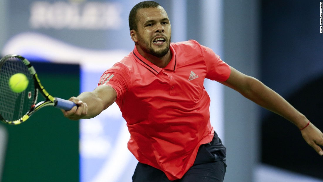 Tsonga of France returns a shot during his final defeat to Djokovic.
