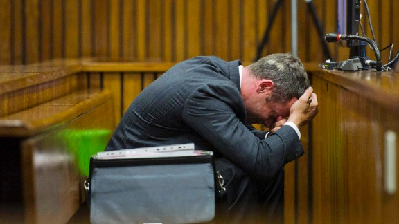 Pistorius puts his head in his hands during his trial in South Africa in March 2014. Pistorius often showed great emotion as the court went into detail about Steenkamp