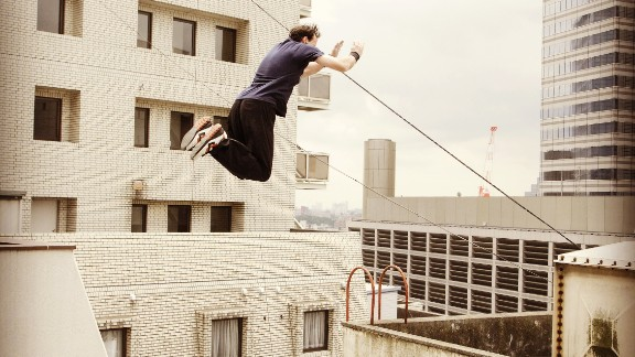 Parkour instructor Dan Edwardes take a spectacular leap in Tokyo.