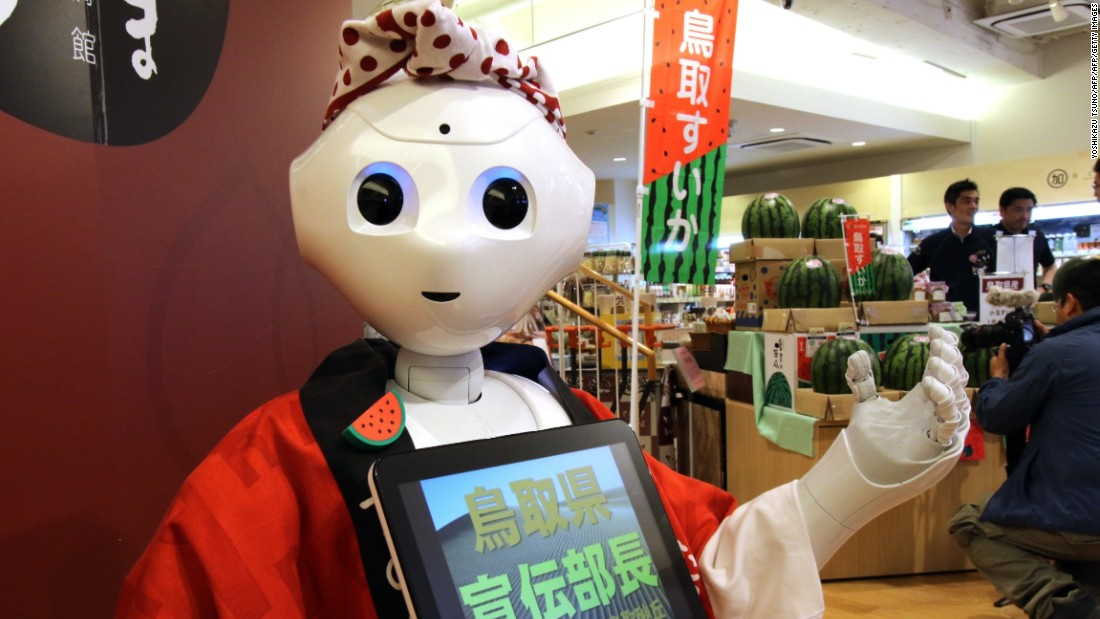 "All 1,000 units of ""Pepper"" being offered in September sold out within one minute, according to its creator Softbank Robotics. ""Pepper"" is being promoted as the world's first personal robot, seen here promoting the sale of watermelons on July 1, 2015. It's also being marketed as a companion for the elderly."