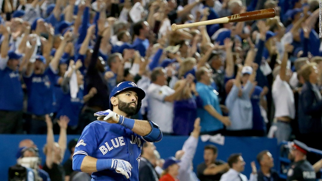 "Toronto slugger Jose Bautista <a href=""http://bleacherreport.com/articles/2579271-jose-bautista-hammers-go-ahead-3-run-homer-vs-rangers-epically-throws-bat"" target=""_blank"">flips his bat</a> Wednesday, October 14, after hitting a go-ahead home run in Game 5 of the American League Division Series. Toronto defeated Texas 6-3 and advanced to the next round of the playoffs."