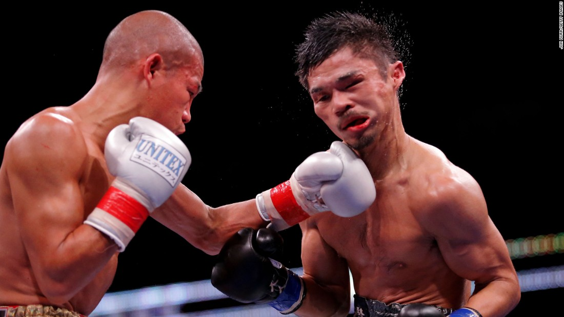 Koki Kameda punches Kohei Kono during their super-flyweight bout in Chicago on Friday, October 16. Kono won by unanimous decision, however, to retain his WBA world title. Kameda retired after the fight.