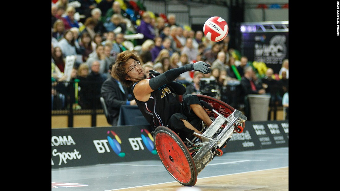 Japan's Daisuke Ikezaki throws a pass before crashing during a wheelchair rugby match in London on Friday, October 16. Japan was playing Australia for the bronze medal in the World Wheelchair Rugby Challenge.