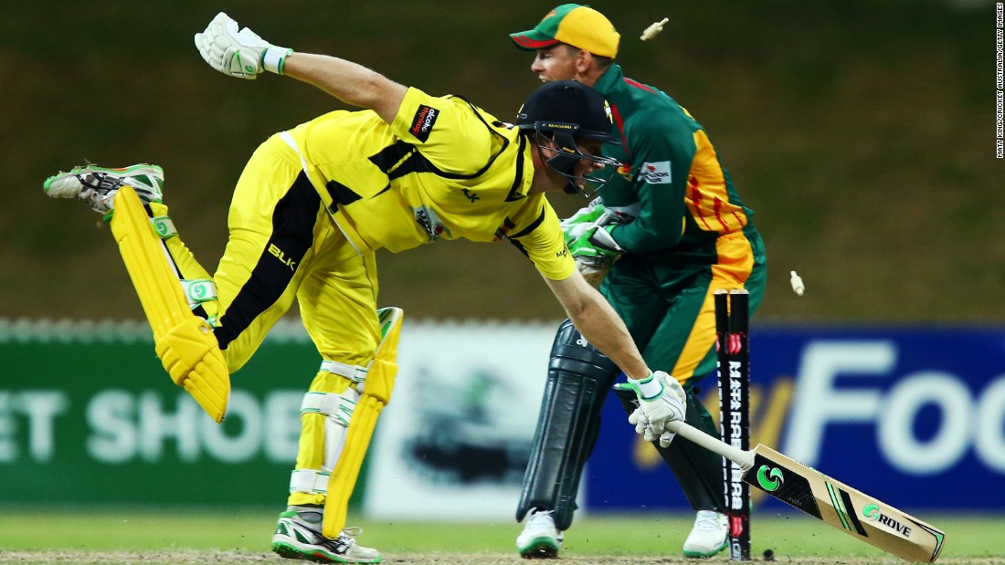 Western Australia's Adam Voges, left, is run out by Tasmania during a cricket match in Sydney on Saturday, October 17.