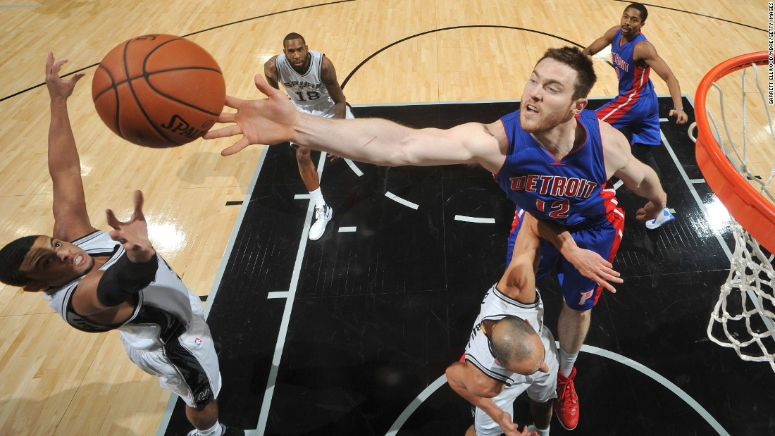San Antonio's Ray McCallum, left, and Detroit's Aron Baynes reach for a rebound during an NBA preseason game in San Antonio on Sunday, October 18.