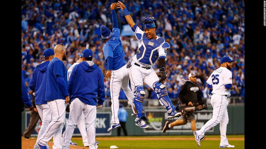 Kansas City catcher Salvador Perez high-fives a teammate after the Royals won Game 2 of the American League Championship Series on Saturday, October 17. Kansas City, last year's American League champions, took a 2-0 series lead against Toronto.