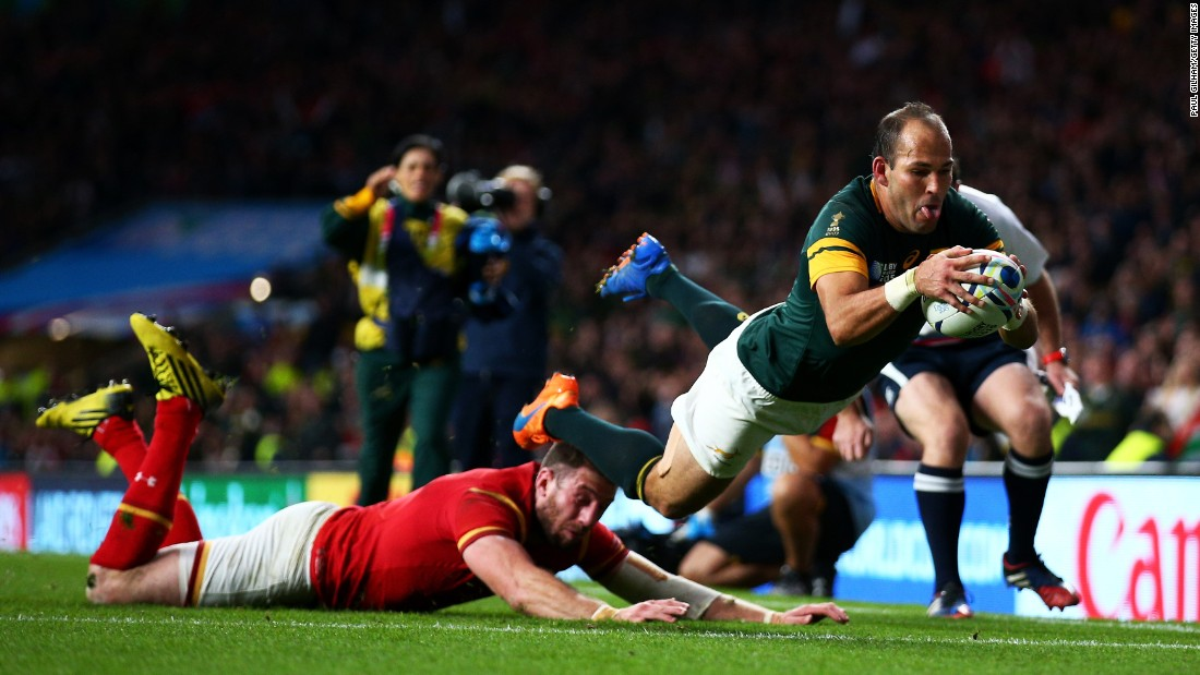 South Africa's Fourie du Preez scores a try against Wales during a Rugby World Cup quarterfinal match on Saturday, October 17. South Africa advanced with a 23-19 victory.