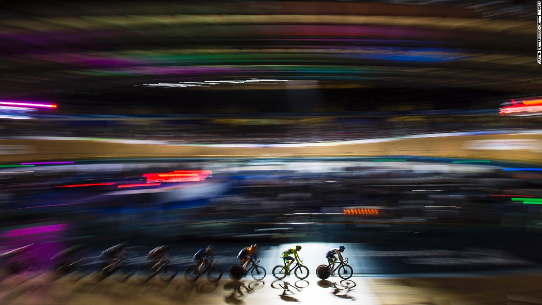 In this photo, shot using a slow shutter speed, cyclists compete in London on Sunday, October 18.