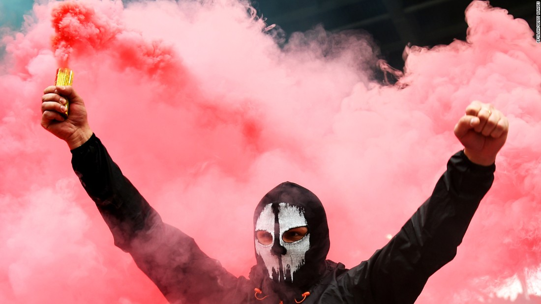 A fan of soccer club Spartak Moscow holds a flare during a match against Lokomotiv Moscow on Sunday, October 18.