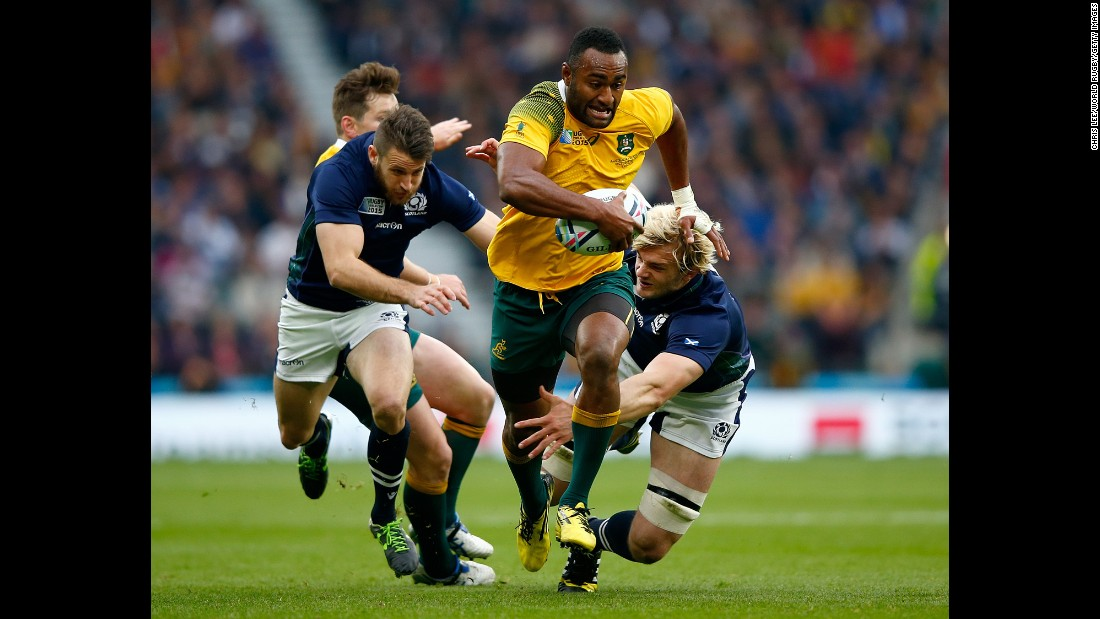 Australian rugby player Tevita Kuridrani breaks away from Scottish players during a Rugby World Cup quarterfinal match on Sunday, October 18. Australia advanced with a 35-34 victory.