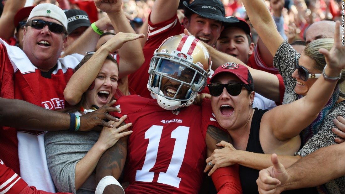 San Francisco wide receiver Quinton Patton celebrates with fans after catching a touchdown against Baltimore on Sunday, October 18. Patton and the 49ers won 25-20 for their second victory of the season.