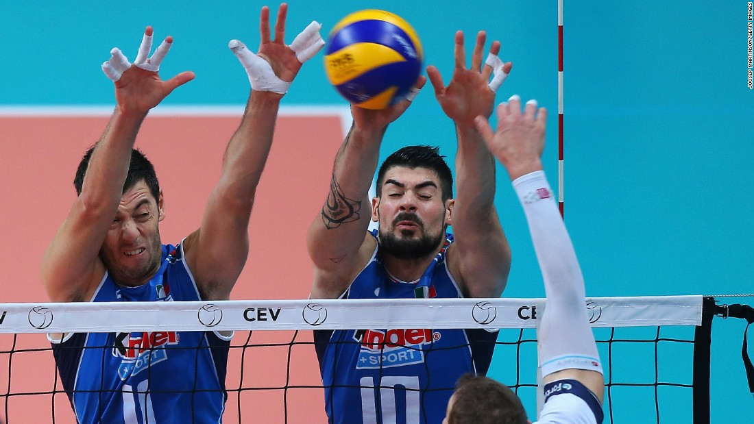 Finland's Olli-Pekka Ojansivu spikes the ball against Italians Simone Buti, left, and Filippo Lanza during a European Championship match Tuesday, October 13, in Busto Arsizio, Italy. Italy won 3-0 and eventually finished the tournament in third place. France defeated Slovenia in the final.
