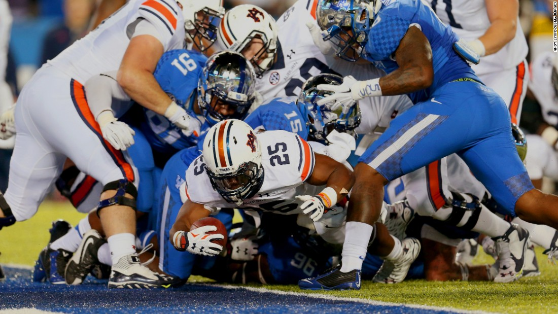Auburn running back Peyton Barber reaches over the goal line to score at Kentucky on Thursday, October 15. Barber had two touchdowns in the game as Auburn won 30-27.