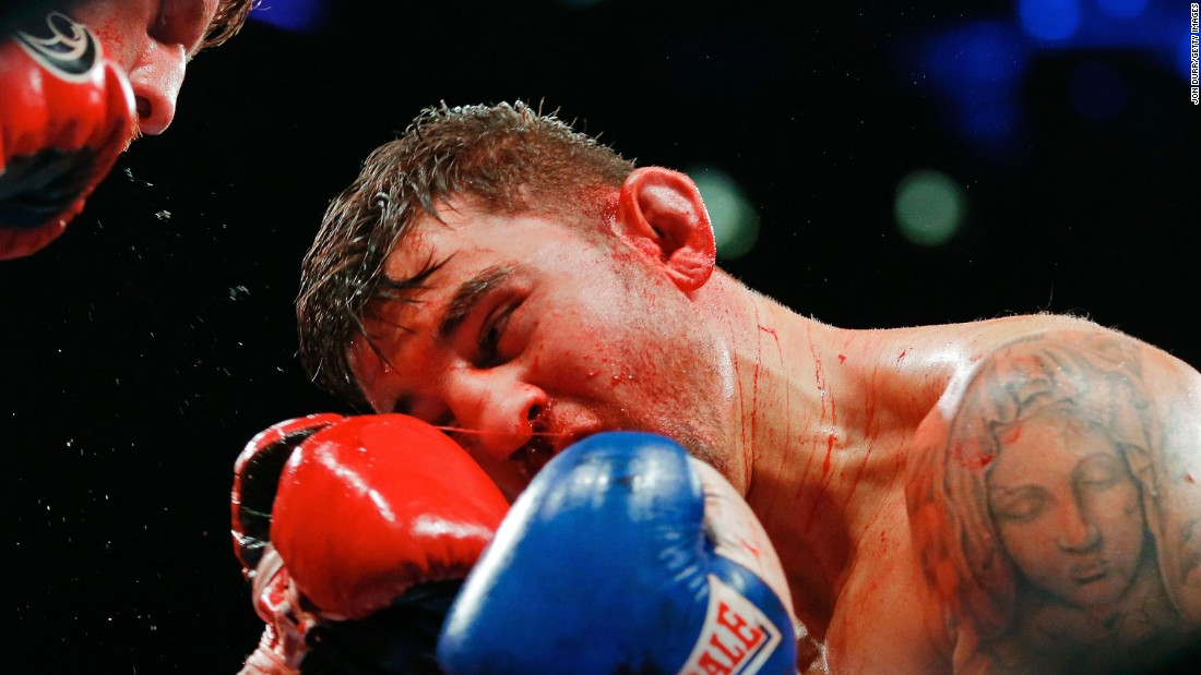 Nathan Cleverly is hit by Andrzej Fonfara during a light-heavyweight bout in Chicago on Friday, October 16. Fonfara won by unanimous decision.