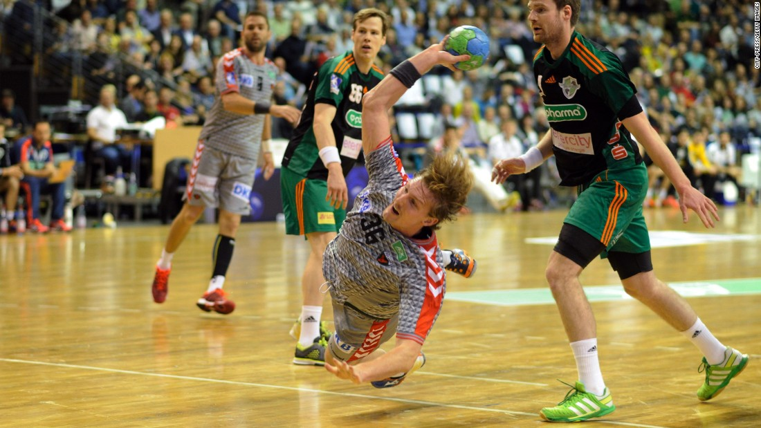 Jesper Nielsen of Fuchse Berlin makes a throw during a handball match against TSV Hannover-Burgdorf on Sunday, October 18.