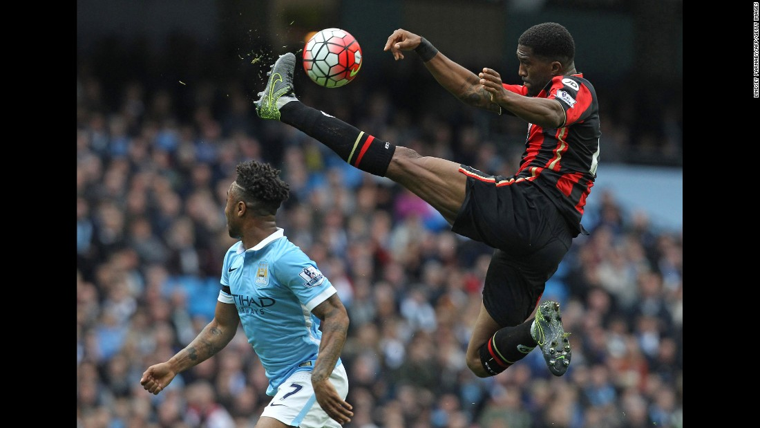 Bournemouth defender Sylvain Distin leaps for a kick during a Premier League match in Manchester, England, on Saturday, October 17.