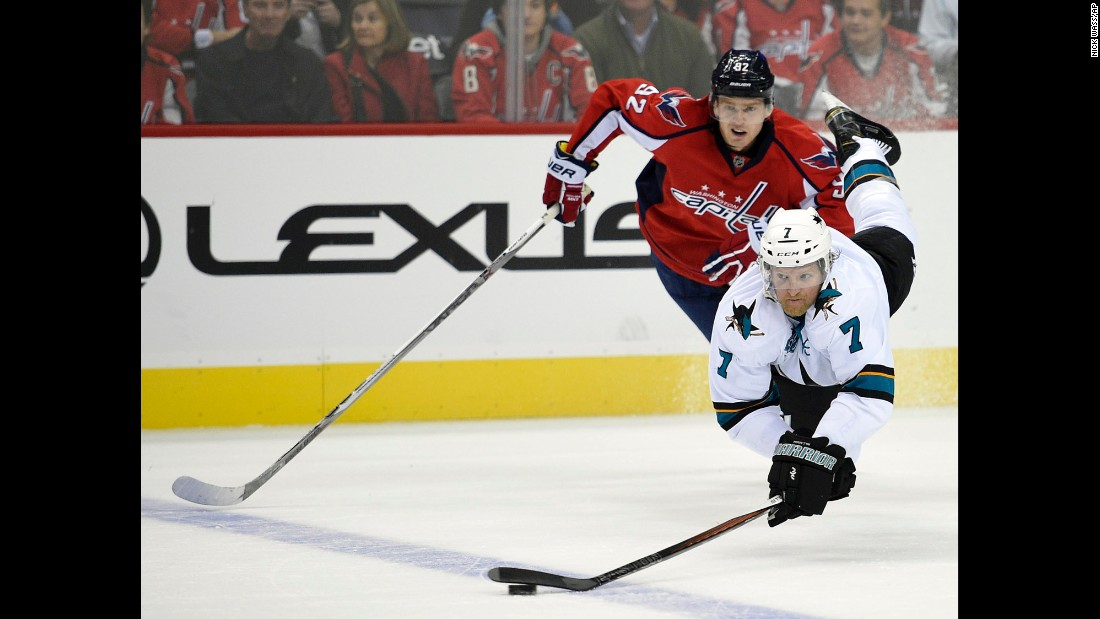 San Jose defenseman Paul Martin reaches for the puck while playing an NHL game in Washington on Tuesday, October 13.